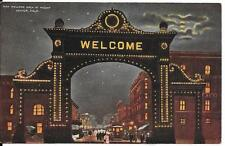 THE WELCOME ARCH AT NIGHT IN DENVER, COLORADO