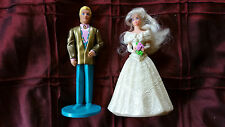Barbie (wedding dress) and Ken (with gold coat and blue pants)
