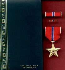 One US Bronze Star medal cased set with ribbon bar and lapel pin in case