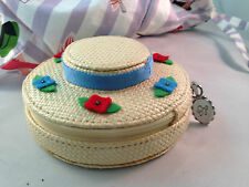 Lulu Guinness Straw hat with colorful flower trim tiny hand bag