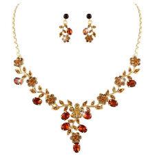 Parure de bijoux dorée soirée fleurs cristal topaze et miel mariage miss mariée