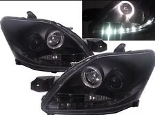 Toyota Yaris projector headlights Devil Eye R8 style Halo Ring Smoke Black 2008+