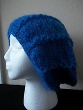 Hand knitted elegant lace pattern hat, beret type, blue