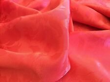 FLOWERS EMBOSSED ON RED SILK POLY- BY THE YARD