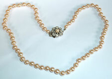 A SIMULATED PEARL NECKLACE WITH ROUND OYSTER COLOURED PEARLS