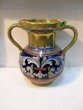 Ancien vase à anses en faïence à décor d'arabesques