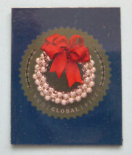 Postage Stamp Magnet With A Silver Bells Holiday Wreath Theme