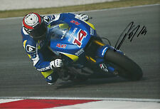 Randy de Puniet Hand Signed Suzuki MotoGP 2014 12x8 Photo.