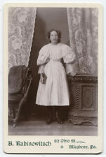 CABINET CARD GIRL HOLDING BOOK. A LOT OF LACE GOING ON. ALLEGHENY CITY, PA.