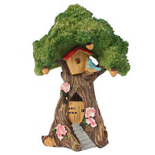 fairy garden tree house features stairs, a door, flowers & a tree house FO_31516
