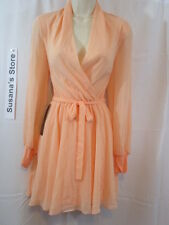 NWT BEBE SURPLICE FLARED DRESS SIZE  M Stunnin georgette dress flaunting a chic