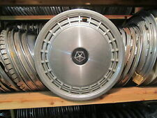 one 1983 to 1987 Dodge Aries Plymouth Reliant 13 inch hubcap wheel cover