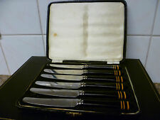 VINTAGE CANTEEN OF SIX STAINLESS STEEL DESSERT KNIVES, WITH BLACK & GOLD HANDLES