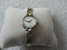 Vintage Caravelle Wind Up Ladies Watch with a Stretch Band and Red Second Hand