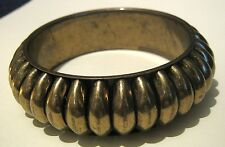 Lovely silver tone metal bangle style bracelet with a chunky raised ridged style
