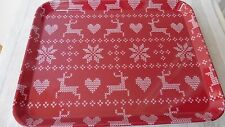 Red plastic rectangle tray with knitted hearts, snowflakes and deer