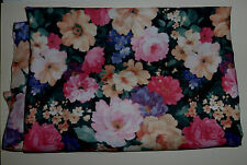 1 metre of peachskin polyester with large pink and cream flowers on green leaves