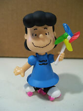 NWOB PEANUTS LUCY ON SKATES WITH PINWHEEL PVC FIGURE JUST PLAY 2015