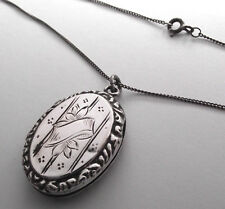 ANTIQUE SOLID SILVER OVAL LOCKET AND SILVER 18 INCH CHAIN HALLMARKED 1915