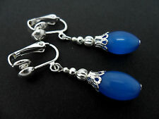 A PAIR OF PRETTY BLUE TIGERS/CATS EYE DROP CLIP ON EARRINGS. NEW.