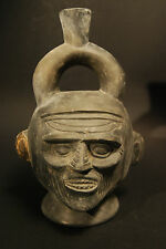 CHIMU BLACK WARE VESSEL WITH OLD MAN FACE   CA.  800 - 1200 A.D.
