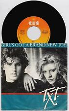 "T.X.T. - GIRL'S GOT A BRAND NEW TOY  45 giri 7"" CBS CBS A 6073 1985 IT"