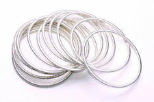 SET OF TWELVE OFF WHITE THREAD COVERED BANGLES FOR CHIC 1960S STYLING (ZX41)