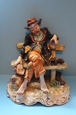 LARGE VINTAGE CAPODIMONTE BUM HOBO TRAMP SITTING ON A BENCH SHOES OFF AND BAG