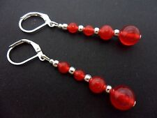 A PAIR OF DANGLY RED JADE SILVER PLATED LEVERBACK HOOK EARRINGS.