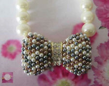 Cream Beaded Pearl Necklace With Multi Colored Pearl Bow Ribbon Design