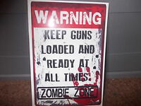 FUNNY A5 LAMINATED WARNING KEEP GUNS LOADED  ZOMBIE ZONE   SIGN