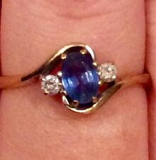 9k gold diamond and blue ceylon sapphire ring. Size R-S