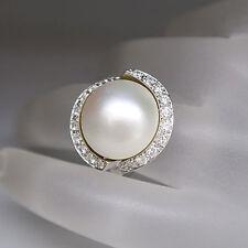 Ring mit einer Mabe Perle und ca. 0,88ct Brillant W-si in 585/14K Weißgold