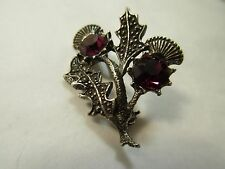 vintage thistle brooch with purple/amethyst colour glass? setting signed miracle