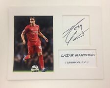 A 22 x 18 cm mounted display personally signed by Lazar Markovic of Liverpool