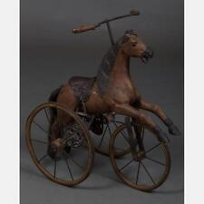 A Contemporary Carved Hardwood and Metal Child's Horse Form Tricycle,... Lot 173