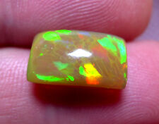 SPLENDIDE OPALE cristal 5,95 CTS FLASHES MULTICOLORS.MINES DE WELO.