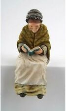 dolls house resin figure of a Grandma sitting