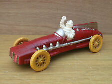 Cast Iron MICHELIN MAN Mr Bibendum waving in RED RACING CAR wheels rotate