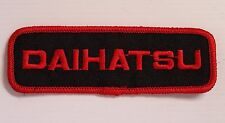 VINTAGE DAIHATSU EMBROIDERED PATCH WOVEN CLOTH BADGE SEW-ON MOTOR RACING RED