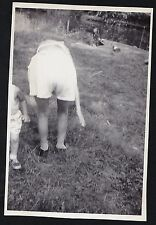 Old Vintage Photograph Woman From Behind Bending Over in Yard