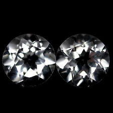 A PAIR OF 6mm ROUND-FACET PURE-WHITE NATURAL AFRICAN TOPAZ GEMSTONES