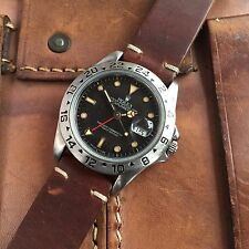 ROLEX EXPLORER 11 GMT WATCH WITH SLIGHTLY TROPICAL DIAL. A GOOD BEATER