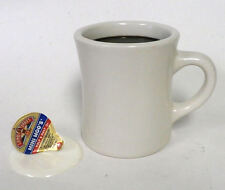 FAKE FOOD DINER MUG OF BLACK COFFEE WITH A SPILLED CREAMER