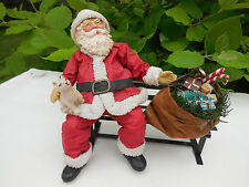 CLOTHTIQUE SANTAS BY POSSIBLE DREAMS SANTA SITTING ON PARK BENCH w/ HIS TOY BAG