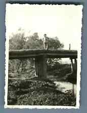 China, Soldier posing on a bridge  Vintage silver print. Vintage China. 中国葡萄酒