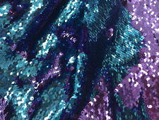 Special reversible sequins mesh lace fabric turquoise and purple. Sold by Yard