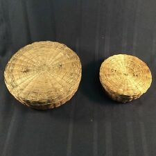 A pair of antique hand woven baskets with covers