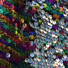 Rainbow/silver two tone dangle 8mm. sequin on poly spandex fabric sold  by yard