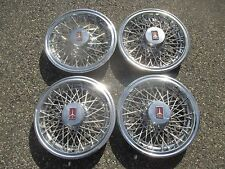 1980 to 1987 Oldsmobile Cutlass 14 inch wire spoke hubcaps wheel covers set